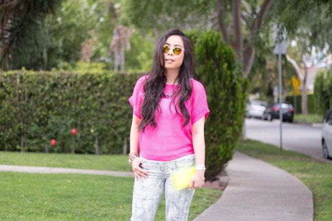 An Dyer wearing Bleulab Marble Tie Dye Jeans, jewelmint Shadow Link Necklace, Zara Neon Yellow Box Clutch, ShopLately Rainbow Mirrored Sunglasses