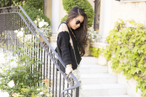 An Dyer wearing Fidelity Whilte Floral Jeans, Rehab Black Sheer Mesh Sweater, Black Cat Eye Metal Sunglasses