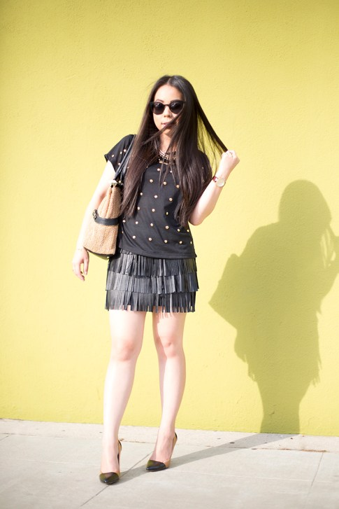 An Dyer wearing Lovers Friends Kiss Me Top, Sole Society Blakeley Nude Black Pumps, Zara Leather Fringe Skirt, Olivia Joy Swanky Straw Satchel, Black Cat Eye Metal Frame Sunglass