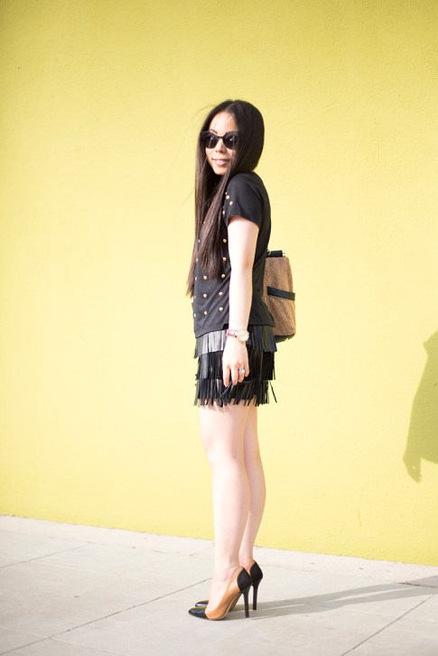 An Dyer wearing Lovers & Friends Kiss Me Top, Sole Society Blakeley Nude Black Pumps, Zara Leather Fringe Skirt, Olivia & Joy Swanky Straw Satchel, Black Cat Eye Metal Frame Sunglasses