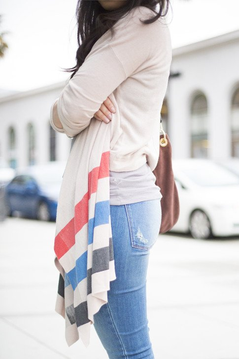 An Dyer wearing DL1961 Jeans, Left on Houston Tribe Cardigan, bmakowsky Brown Leather Hobo Bag