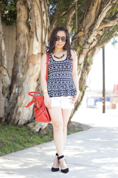 An Dyer wearing JewelMint Tribal Fringe Necklace, ShoeMint Lola Pumps, Torn by Ronny Kobo Michaela Tribal Peplum Tank, Mi Piaci Cuff, Vaunt Snake Aviators, Red V-Couture by Kooba Studded Bag