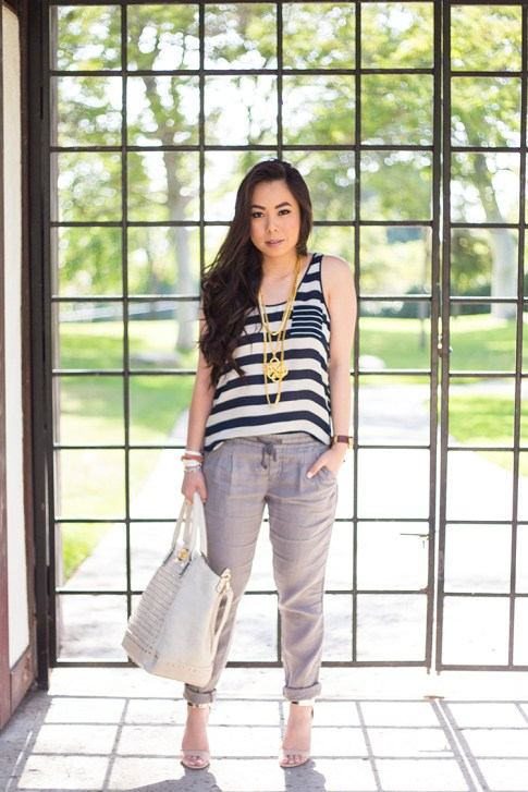 An Dyer wearing Michael Stars Stripe Silk Georgette Scoop Neck Tank Cuffed Ankle Pant w Tuxedo Stripe, Ben-Amun Layered Pendant Necklace, Frederick's of Hollywood Cream Studded Tote Bag, Sole Society Bracelets, Hermes Hapi 3