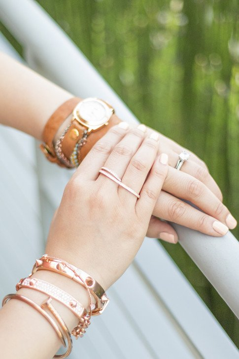An Dyer wearing Natalie B Rose Gold Double Finger Ring, Glint & Gleam Rose Gold Bracelet Nail Bangles ShopLately, LaMere Collections Wrap Watch