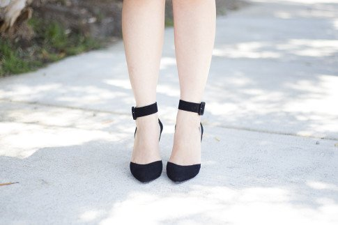 An Dyer wearing ShoeMint Black Suede Lola Pumps