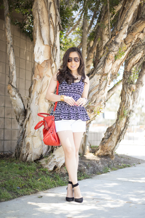 An Dyer wearing ShoeMint Lola Pumps, Torn by Ronny Kobo Michaela Tribal Peplum Tank, Mi Piaci Cuff, Vaunt Snake Aviators, Red V-Couture by Kooba Bag