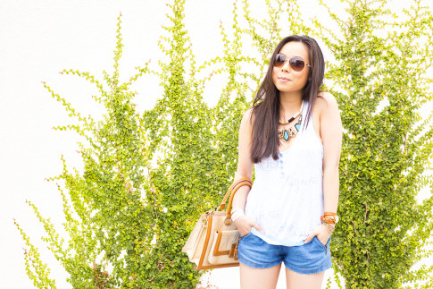 An Dyer wearing Brahmin Atelier Brookline Satchel Tan, Zara Chambray Denim Shorts, Foster Grant Aviator Sunglasses, Honeydew Intimates Diamondback Cami, La Mer Collections Watch