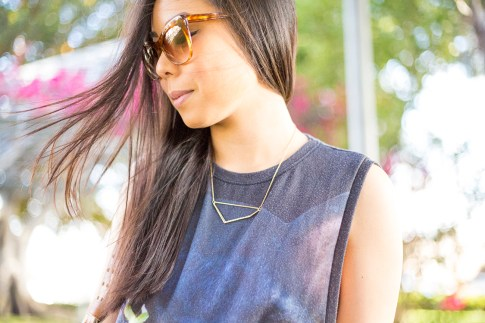 An Dyer wearing Elizabeth & James Lafayette Sunglasses and Glint & Gleam Shifting Shape Necklace ShopLately
