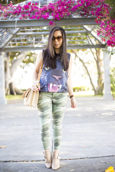 An Dyer wearing Forever 21 Jaguar Tank, Elizabeth & James Lafayette Sunglasses, Shifting Shape Necklace ShopLately, Brahmin Atelier Brookline Satchel, CJ by Cookie Johnson Camo Jeans, ShoeMint Milly bootie