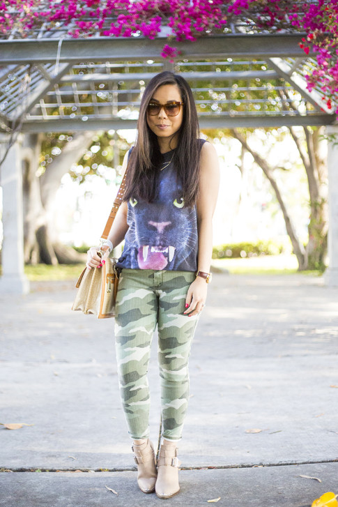 An Dyer wearing Forever 21 Jaguar Tank, Elizabeth & James Lafayette Sunglasses, Shifting Shape Necklace ShopLately, Brahmin Atelier Brookline Satchel, CJ by Cookie Johnson Camo Jeans, ShoeMint Milly boots