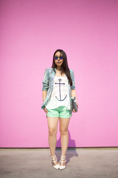 An Dyer wearing Lovers+Friends x Stylyt Bombshell Blazer, Vintage Havana Nautical Anchor Top, Allison Collection Silk Shorts, ShoeDazzle White Sahara Studded Pumps, George Gina Lucy Purple Mirrored Sunglasses, Mujjo ipad
