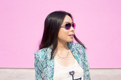 An Dyer wearing Lovers+Friends x Stylyt Bombshell Blazer, Vintage Havana Nautical Anchor Top, Mason Grace Triangle Collar Necklace, George Gina Lucy Purple Mirrored Sunglasses