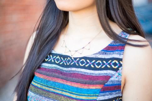 An Dyer wearing Mason Grace Jewelry Triangle Collar Necklace, Vintage Havana Tribal Top