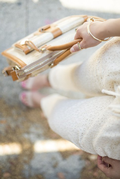An Dyer wearing Piper Gore Clementine Lace Pant, Bebe Jacqueline Sandals, Brahmin Atelier Brookline Satchel Taupe