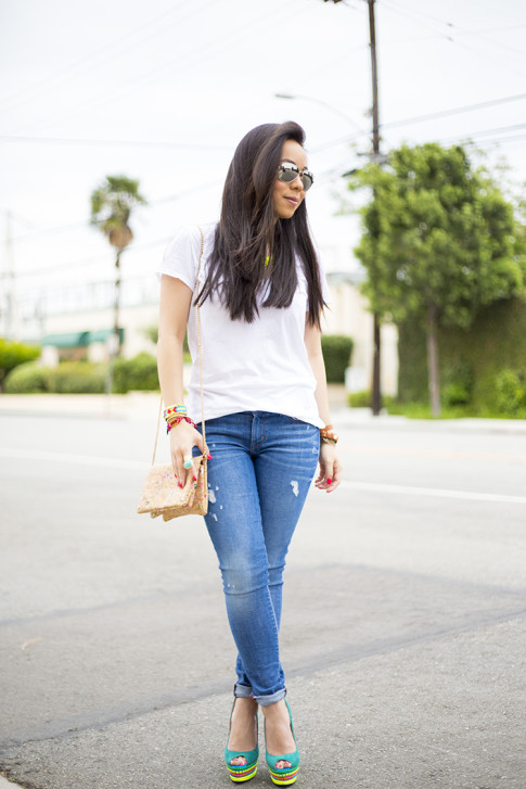 An Dyer wearing ShoeDazzle Jaleen Green, Rich & Skinny Clinton Ankle Peg Jeans, ShopLately Glint & Gleam Neon Necklace & multicolor Cork Clutch, Kim & Zozi Bracelets, Mirrored Sunglasses, Michael Stars