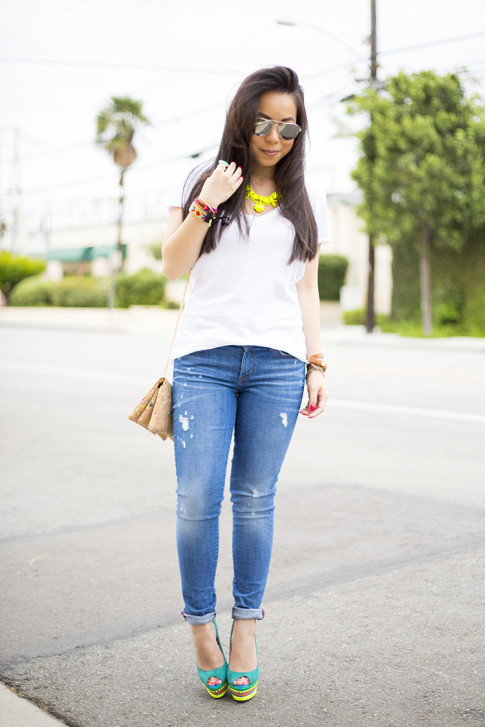 An Dyer wearing ShoeDazzle Jaleen Green, Rich & Skinny Clinton Ankle Peg Jeans, ShopLately Glint & Gleam Neon Necklace & multicolor Cork Clutch, La mer Collections Watch, Mirrored Sunglasses