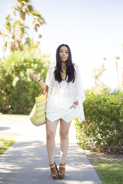 An Dyer wearing Sole Society Keeva Tote, Daniella Wedges and Citrine OVERSIZED FLORAL NECKLACE, LIV los angeles crochette caftan, La Mer Collection Watch, Zara White Skort