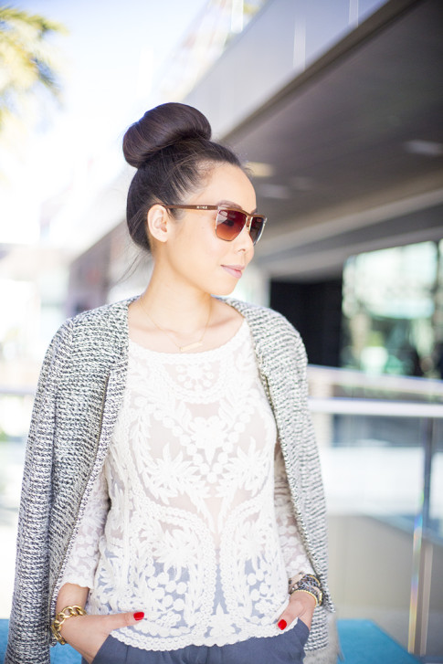 An Dyer wearing LOFT Peplum Tweed Jacket, BCBGMaxazria Square Aviators DBALovingThis, hair in top knot, sock bun, donut bun