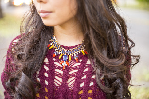 An Dyer wearing heartLoom Samara Knitted Sweater in Burgundy & Prima Donna Cosmopolitan Suede Braided Chain Necklace