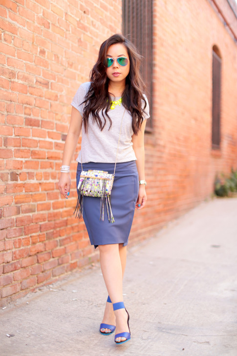 An Dyer wearing Foster Grant Blue Mirrored Aviator Sunglasses, Neon Yellow Necklace and The One by Cotton On Tee, Katherine Kwei Fringe Crossbody, Chaiken Skirt, ShoeDazzle Kaleen, Hermes Hapi