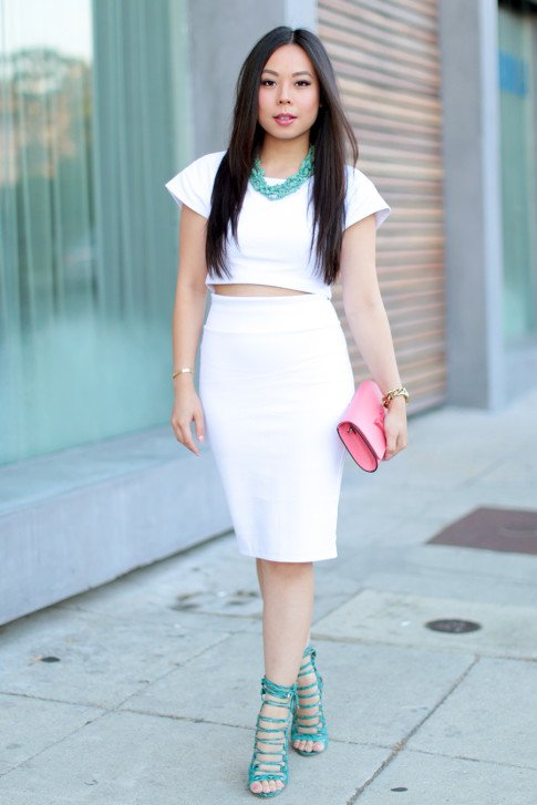 An Dyer wearing All White Bebe Crop Top and High Waisted WHite Skirt Street Style