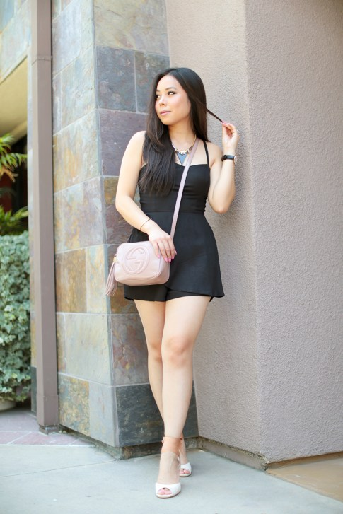 An Dyer wearing Della Urban Outfitters Black Romper, Gucci Soho Disco Bag, Tsubo Novelle Wedges