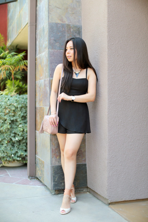 An Dyer wearing Della Urban Outfitters Black Romper, Gucci Soho Disco, BooHoo Necklace Tsubo Novelle Wedges