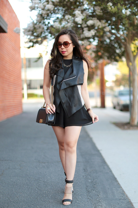 An Dyer wearing Karen Kane Tweed Leather Vest, Foster Grant Vintage Round Sunglasses, Chanel Boy Bag old medium lambskin ghw, bebe chiffon shorts, shoedazzle Rayna