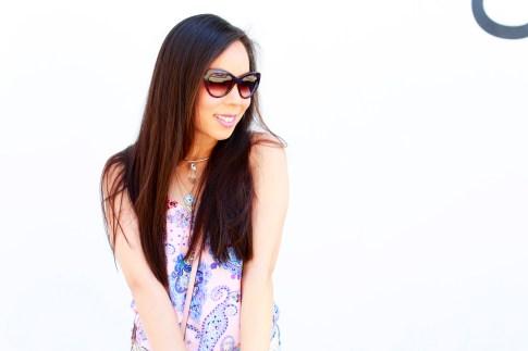 An Dyer smiling wearing Bulgari Sunglasses