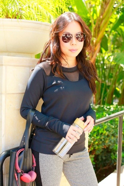 An Dyer wearing ALALA NEOPRENE SWEATSHIRT with Fressko Flask
