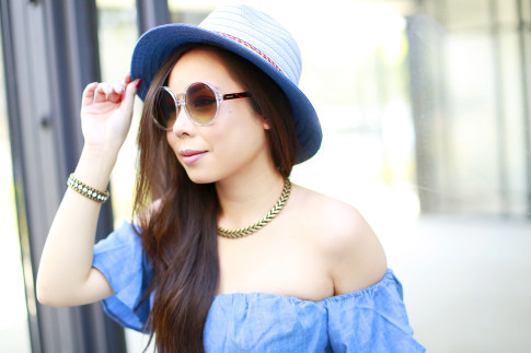 An Dyer wearing BCBG Blue Fedora Hat