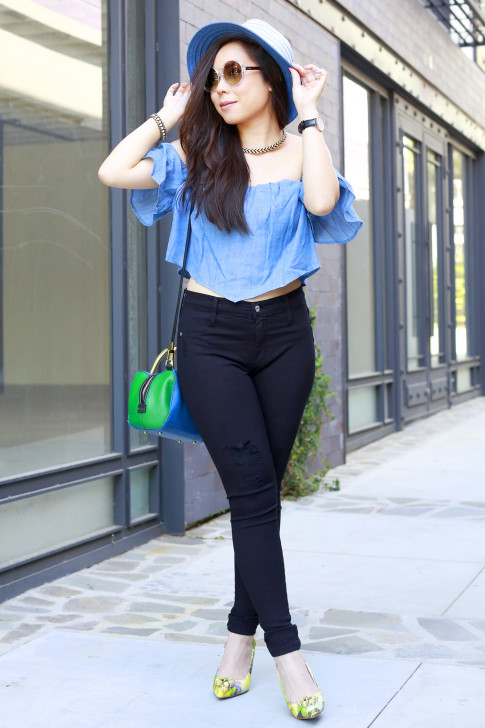 An Dyer wearing Blue Fedora with Guess denim off the shoulder top and green floral pumps