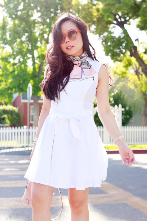 An Dyer wearing Celine Audrey Pink Sunglasses, Louis Vuitton Trunks Scarf, White Moto Dress Marciano
