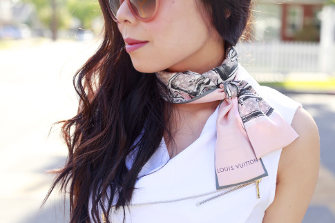 An Dyer wearing Louis Vuitton Trunks Scarf around neck