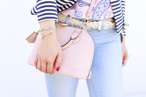 An Dyer wearing Miansai Anchor rope Bracelet carrying Louis Vuitton Alma BB Magnolia Pale Baby Pink