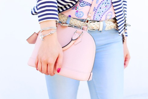 An Dyer wearing Miansai Anchor rope Bracelet carrying Louis Vuitton Alma BB Magnolia Pale Baby Pink