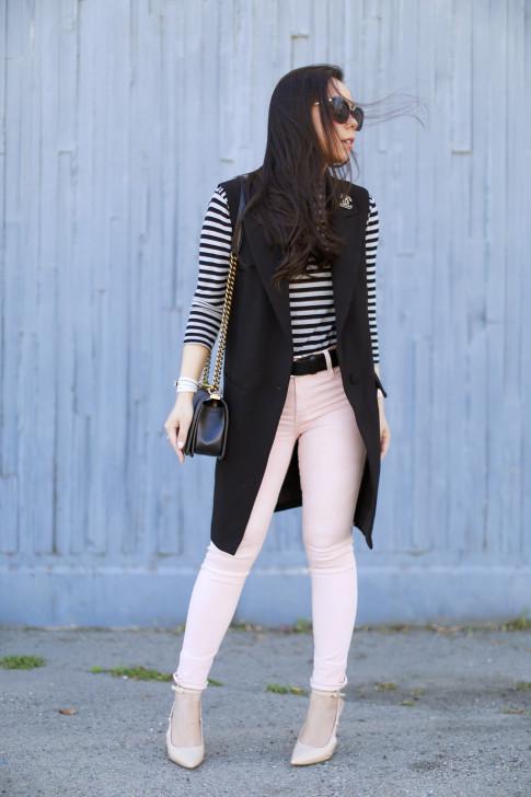 An Dyer wearing Pink Camo James Jeans, Sleeveless vest Coat, Chanel Brooch
