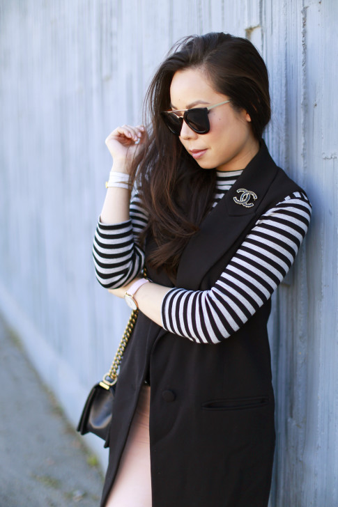 An Dyer wearing Stripe shirt with sleeveless coat vest blazer chanel brooch