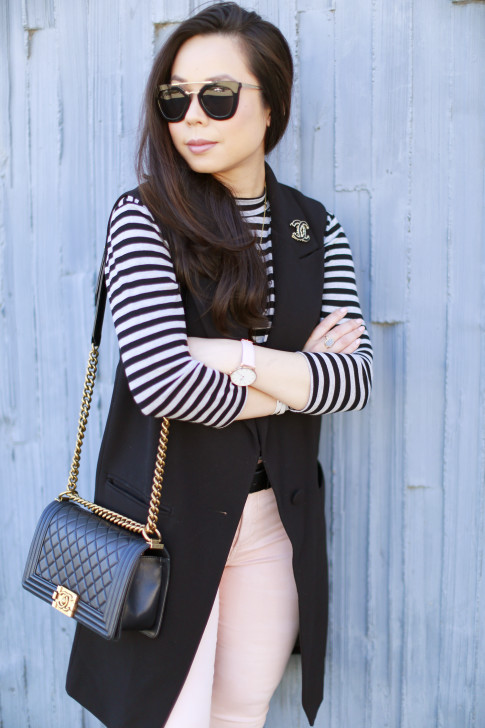 An Dyer wearing Striped Shirt with sleeveless coat pink jeans chanel boy bag