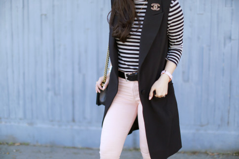 An Dyer wearing Stripes, long vest, pink jeans