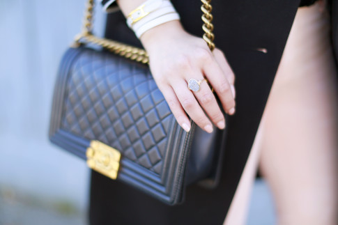 An Dyer wearing Wren Ring with Chanel Boy Bag