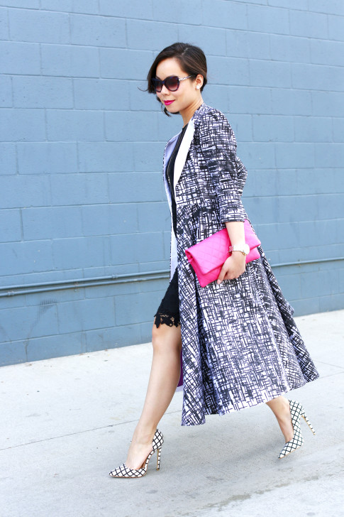 An Dyer wearing CHanel Pink Clutch, Bulgari Sunglasses with Doku AME'YO MARBLE LONG COAT and JustFab Windowpane Pumps