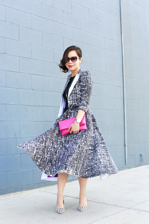 An Dyer wearing Chanel Pink QUilted Clutch, Bulgari Sunglasses with Doku AME'YO MARBLE LONG COAT, and JustFab Windowpane Pumps