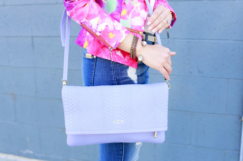 An Dyer wearing Honey & Beau Eternal Blossom Jacket with Loren Hope Bracelets and gigi New York Carly Clutch Lavender