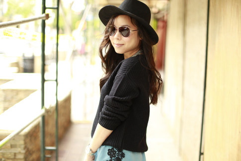 An Dyer wearing black fedora panama hat