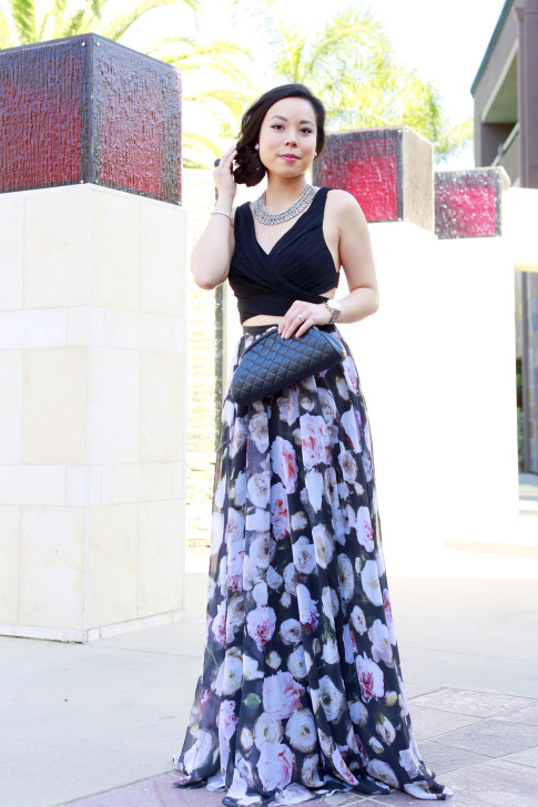An Dyer wearing hair up in side updo Juliet Co Necklace with Fame and Partners Rose Floral Two Piece with Chanel Kisslock Clutch