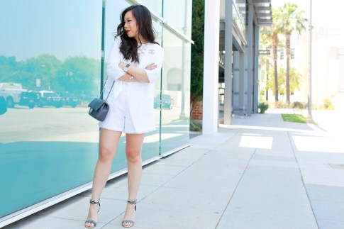 An Dyer wearing Chanel Chevron Flap Bag and Chanel Brooch with Eve by Eve's White Tweed Short Set with Lace Top and ShoeDazzle Sandals