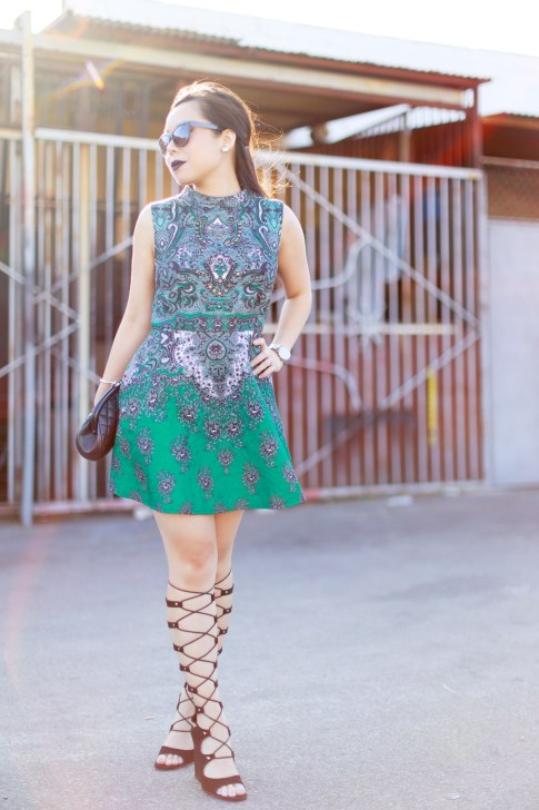 An Dyer wearing Chanel Clutch, ChicWish Dress, ShoeDazzle Gladiator Wedge Lace Up Sandals