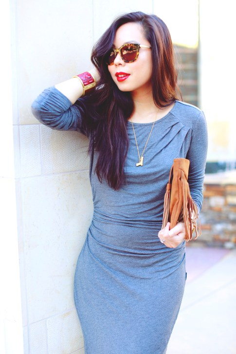 An Dyer wearing JustFab Grey Ruched Dress, Suede Fringe Clutch