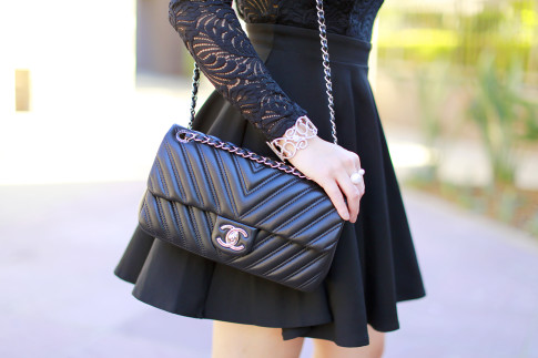 An Dyer wearing Chanel Like A Chevron Black Silver Hardware Flap 15B